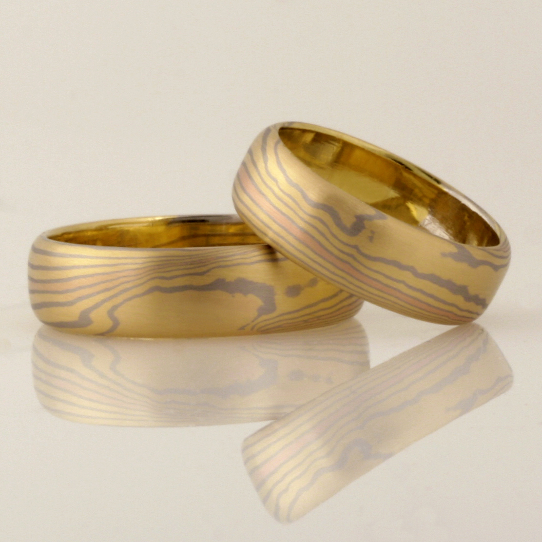 "R063 Handmade & Designed by Robert Paul. 18ct yellow, white and rose gold ladies 1/2 round Mokume Gane wedding ring. Size ""Q"" $3000"