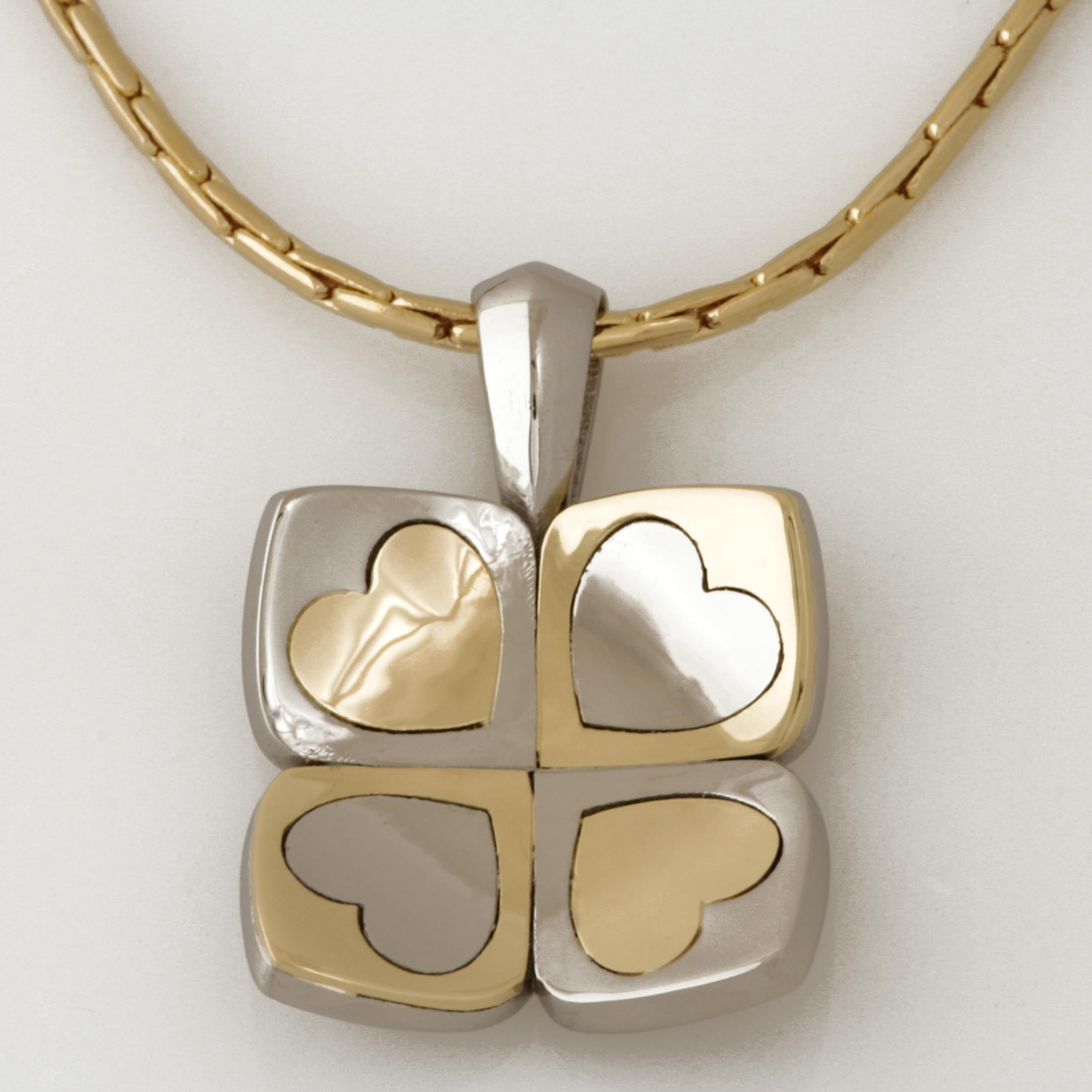 'PLAY' heart pendant made in palladium and 18ct yellow gold