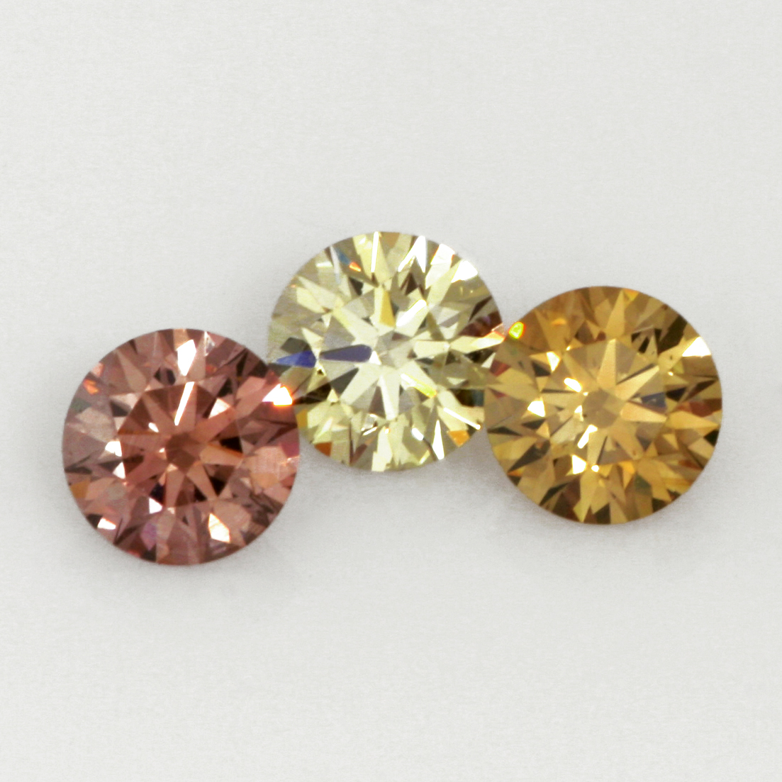Natural Coloured EightStar Diamonds. Left to right – Fancy brown pink, Fancy brownish green yellow & Fancy brown yellow