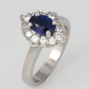 Handmade ladies palladium oval sapphire and diamond engagement ring