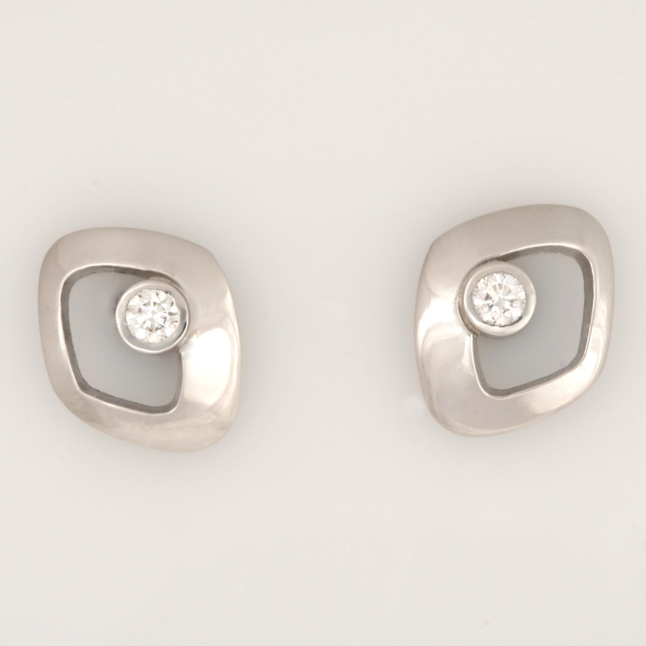 Handmade ladies platinum diamond earrings