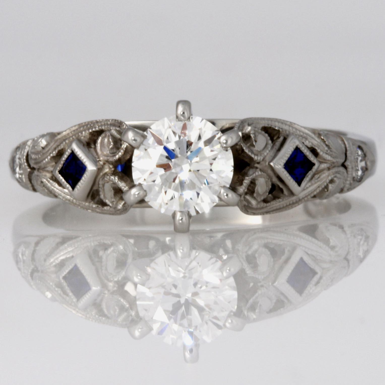 Handmade ladies platinum diamond and blue sapphire engagement ring