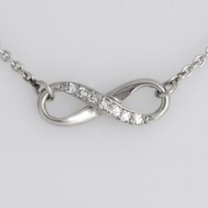 Handmade ladies palladium diamond Infinity pendant