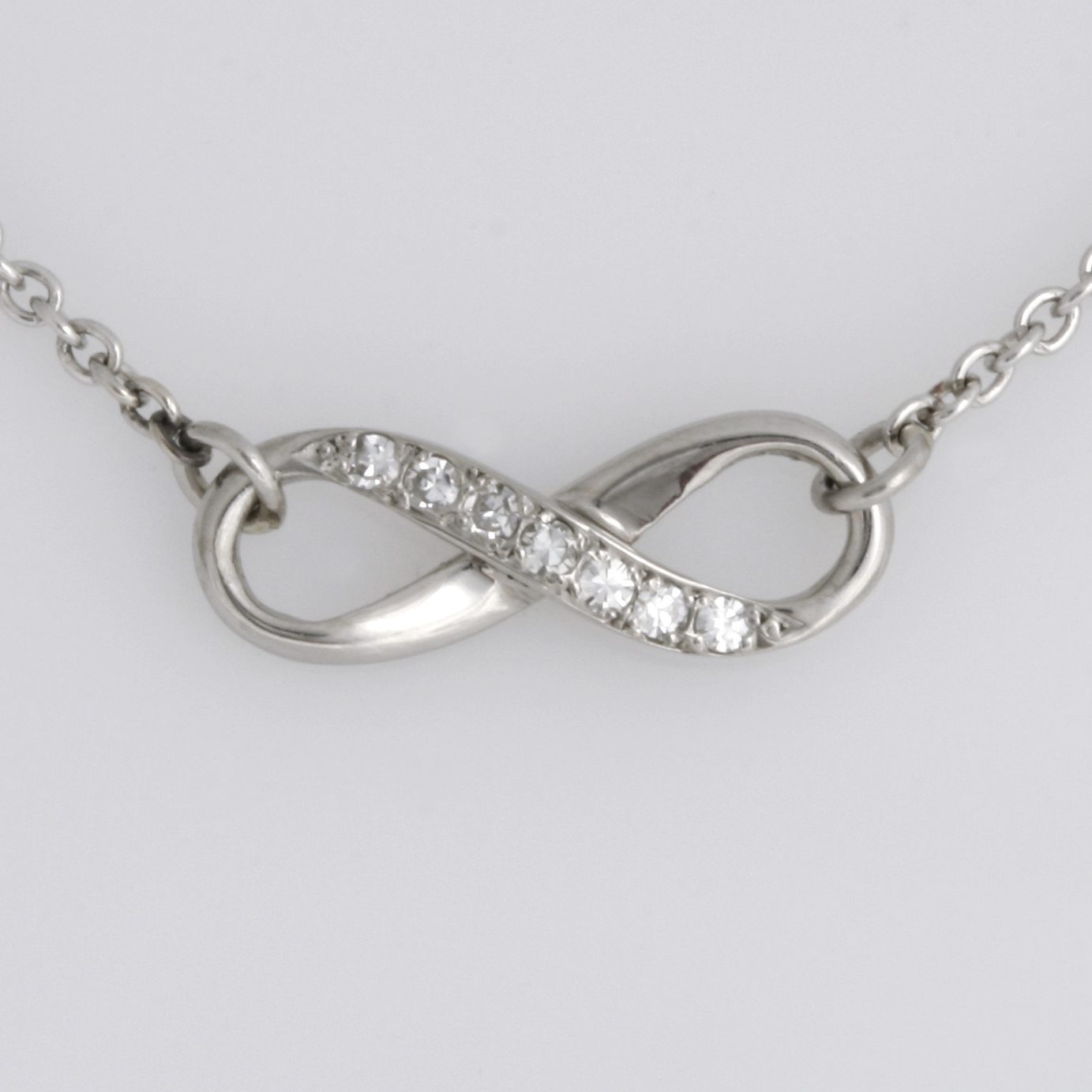 Handmade ladies palladium diamond Infinity pendant