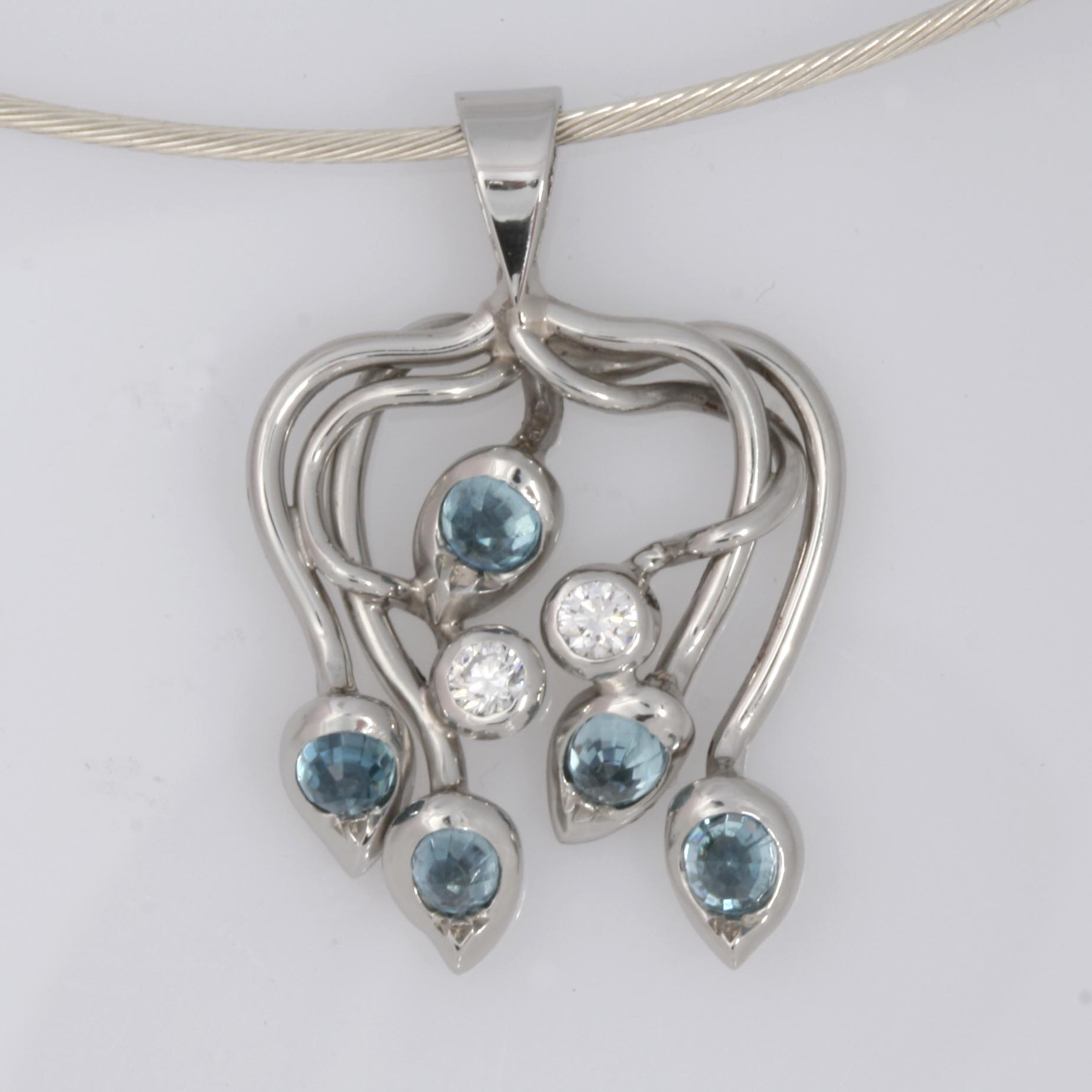 Handmade ladies palladium blue zircon and diamond pendant