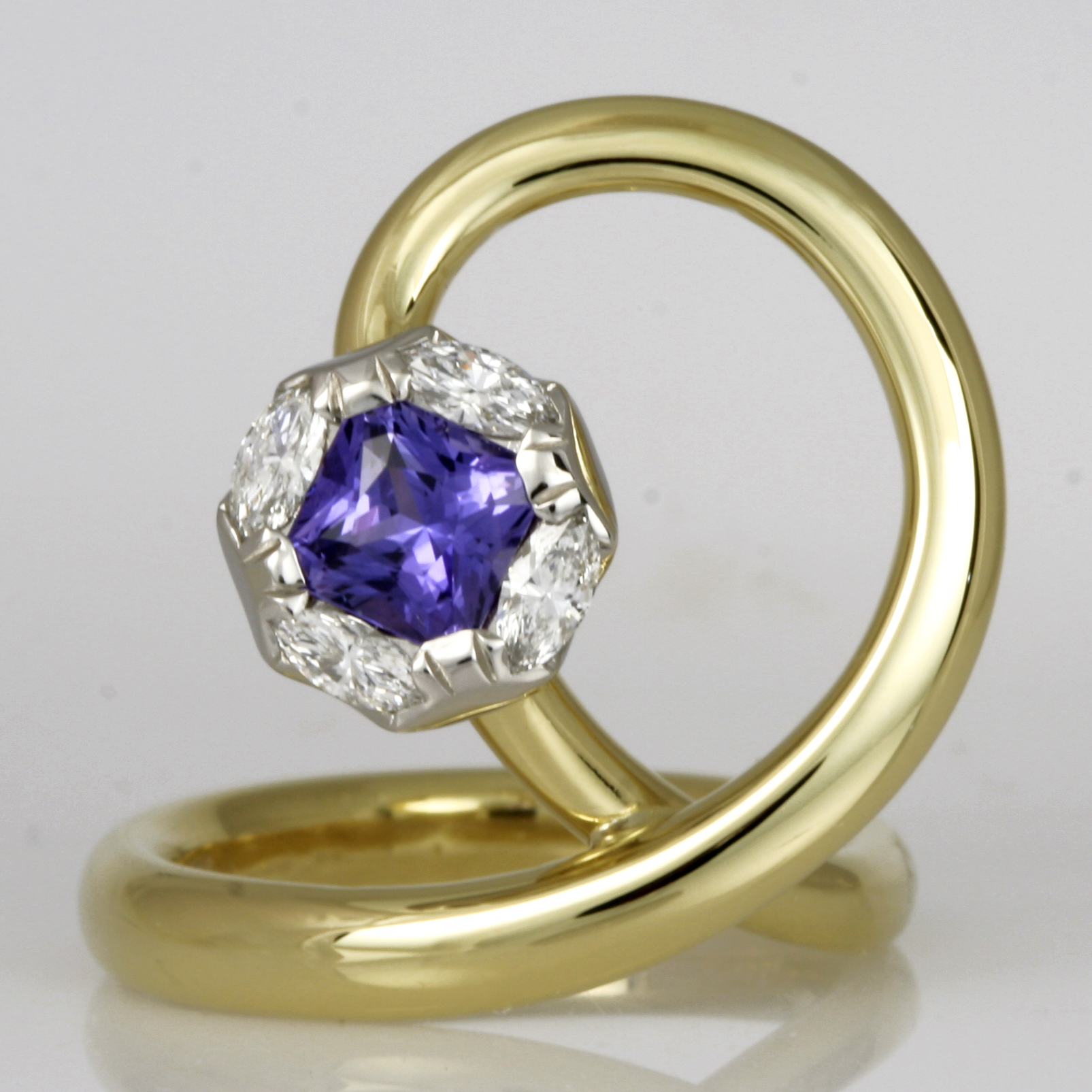 Handmade ladies 18ct green gold and palladium ring featuring a square radiant cut purple sapphire and marquise diamonds
