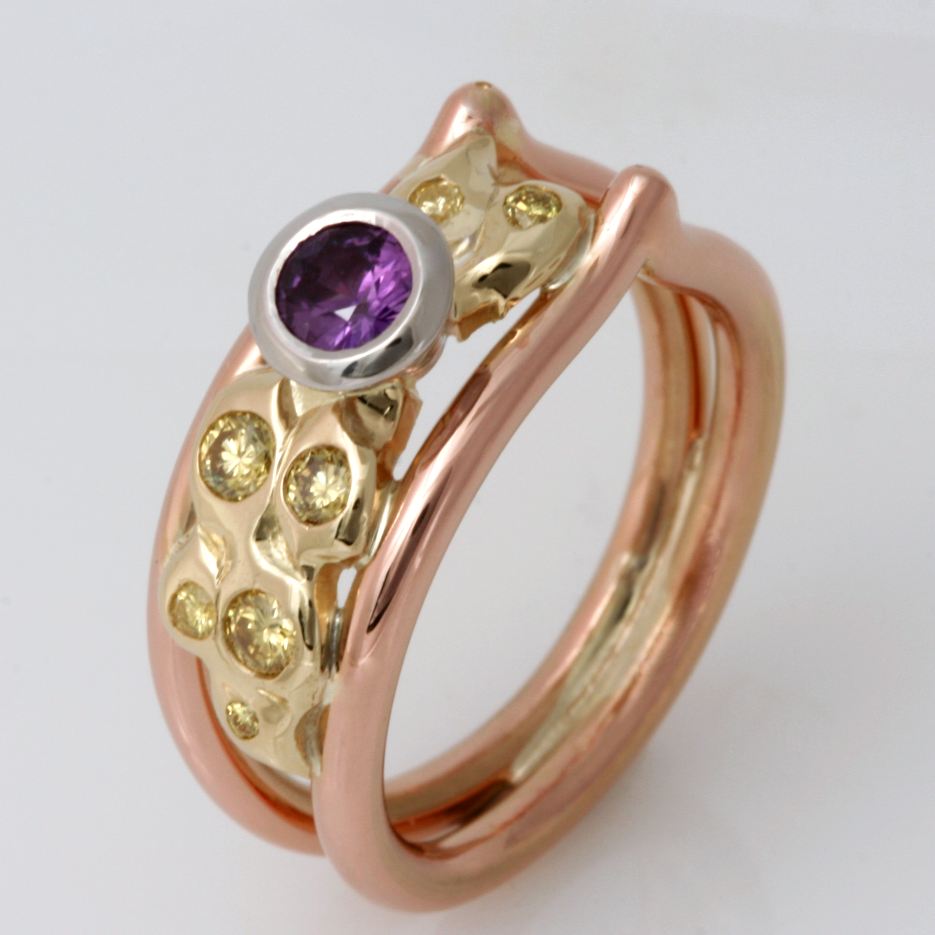 Handmade ladies palladium, 18ct green gold and 18ct rose gold ring featuring a purple sapphire and yellow diamonds