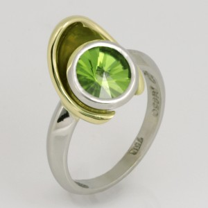 Handmade ladies palladium and 18ct green gold ring featuring a spirit cut peridot