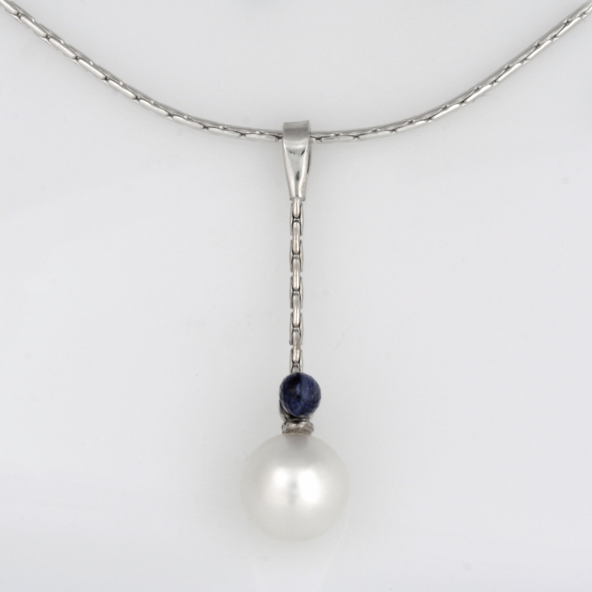 Handmade palladium and white gold south sea pearl and ceylon sapphire briolette pendant featured on a 14ct white gold chain