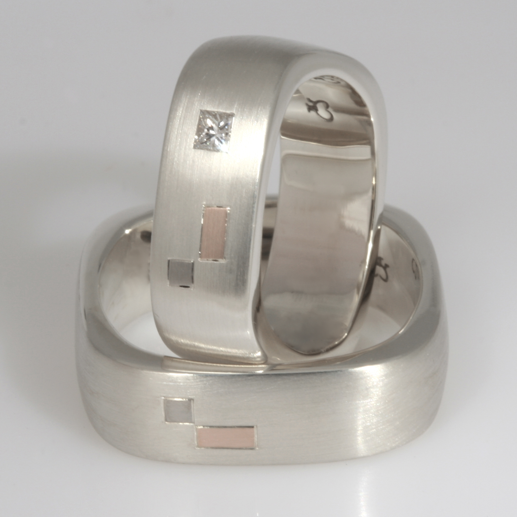 Handmade 9ct white gold ladies and gents square wedding rings featuring 18ct rose gold and 18ct white gold inlays
