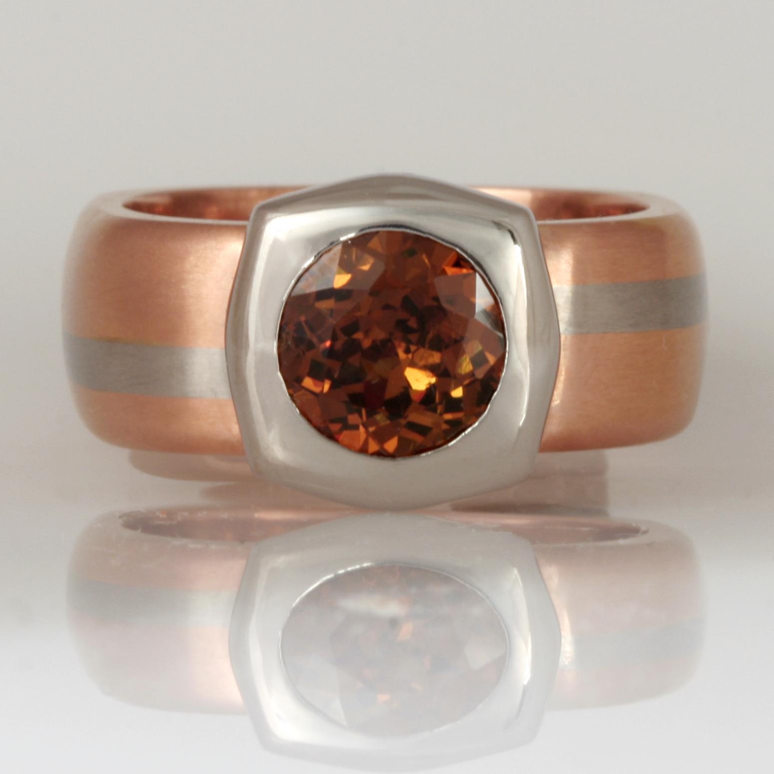 Handmade ladies palladium and 18ct rose gold ring featuring a demantoid garnet