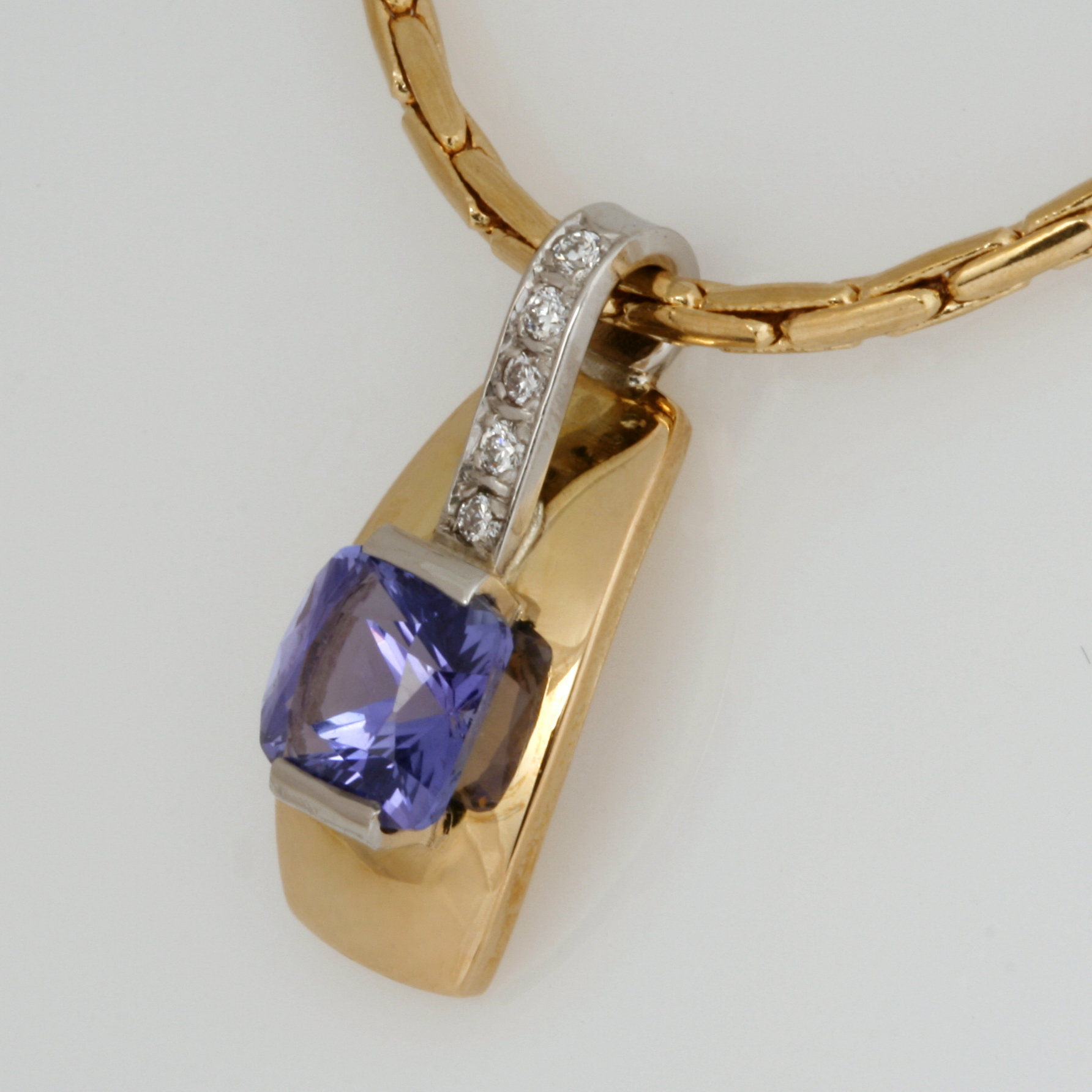 Handmade ladies 18ct yellow gold and palladium pendant featuring a tanzanite and diamonds