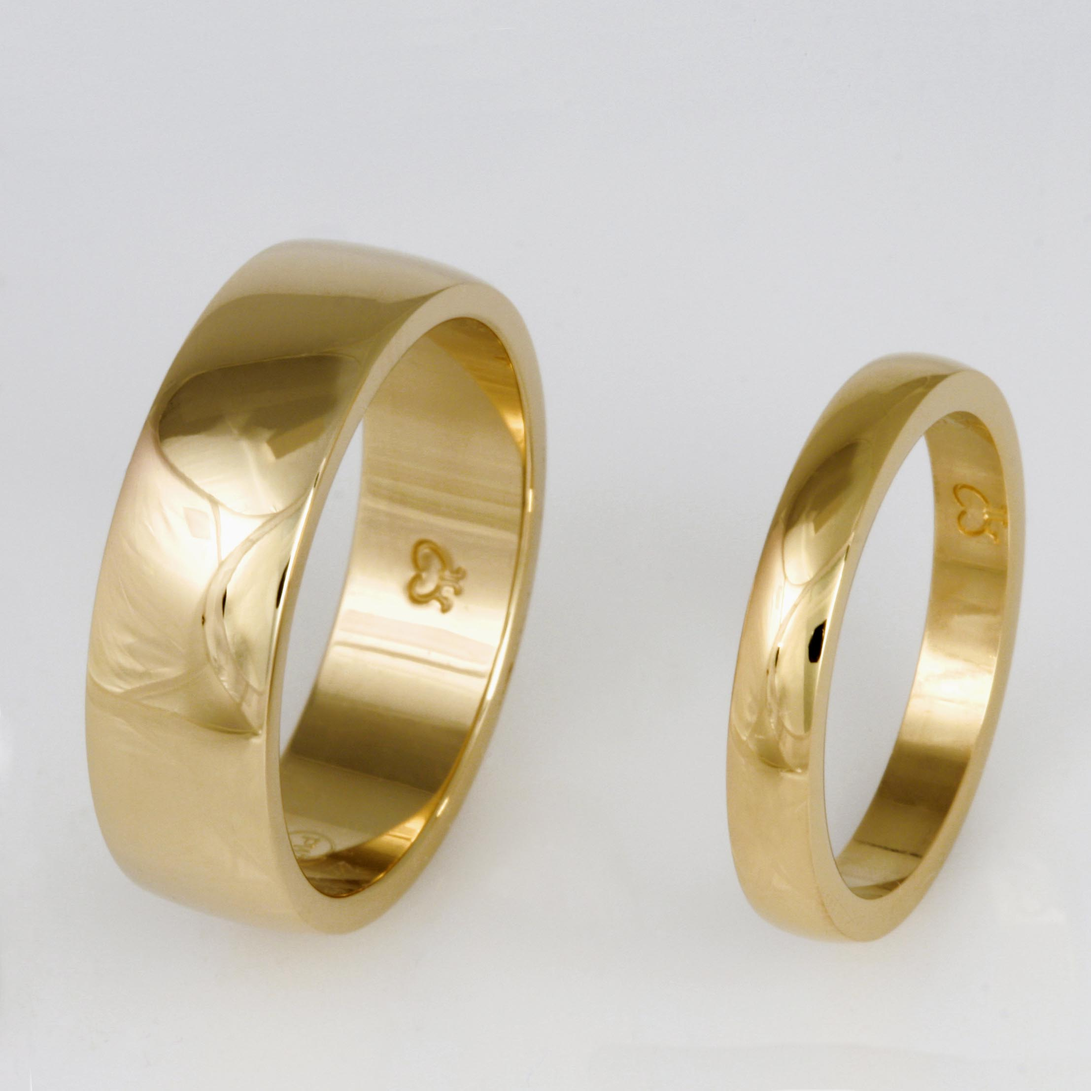 Handmade ladies 18ct yellow gold and gents 14ct yellow gold wedding rings