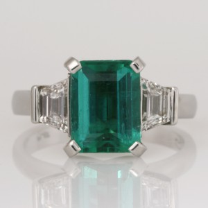 Handmade ladies platinum ring featuring an emerald cut 2.36ct Colombian Emerald and diamond