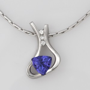 Handmade ladies palladium tanzanite and diamond pendant featured on a 14ct white gold chain