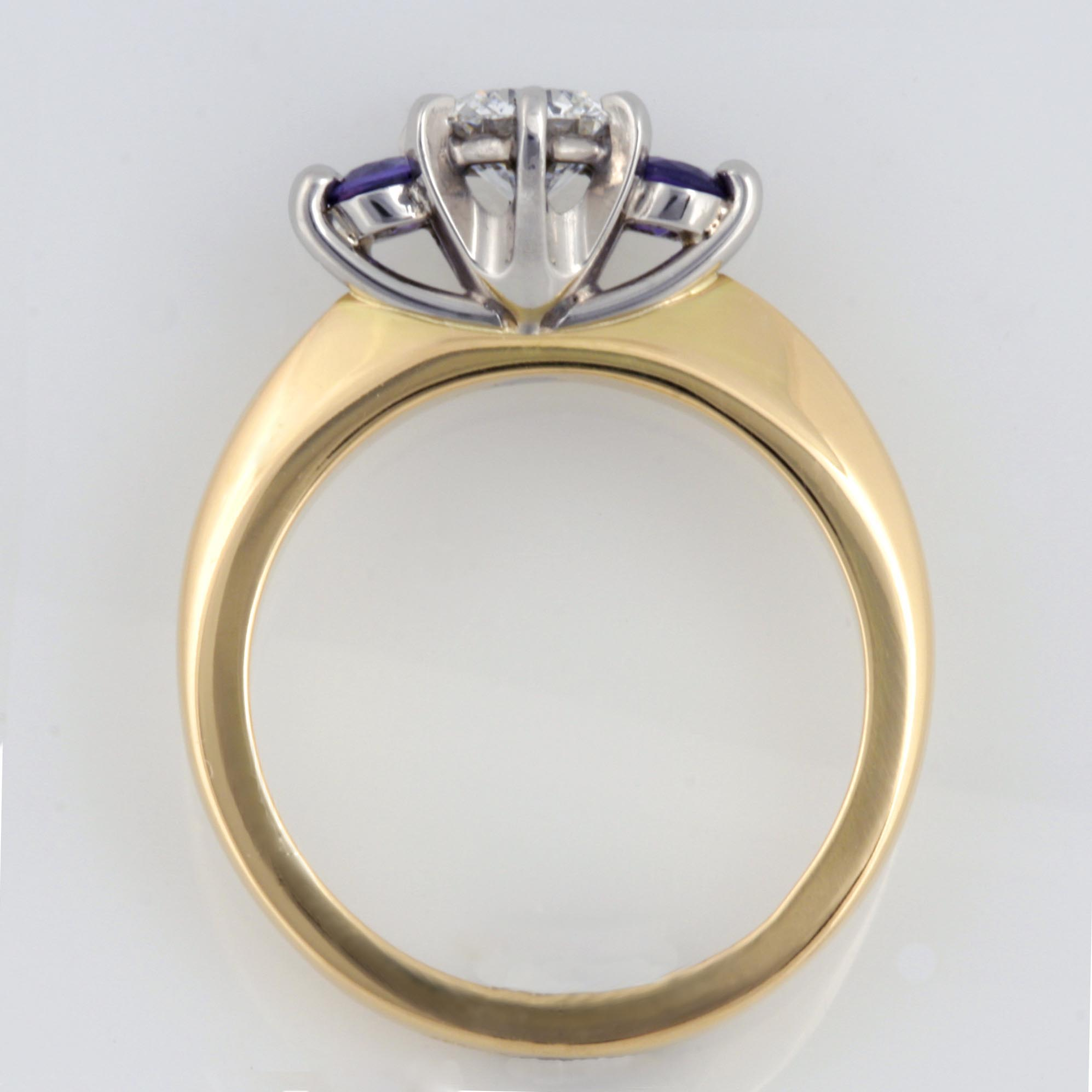 Handmade ladies 18ct yellow gold and palladium engagement ring featuring a brilliant cut diamond and purple sapphires