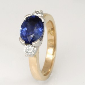 Handmade ladies 18ct yellow gold and palladium ring featuring a ceylon sapphire and diamonds