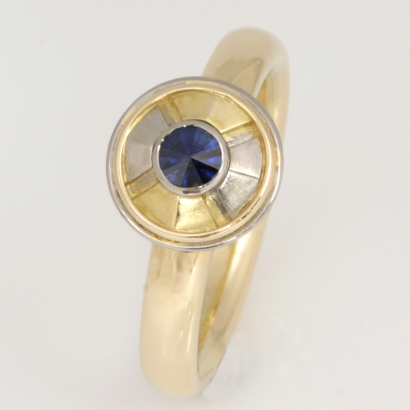 R054 Ladies 18ct yellow and white gold pie section ring featuring a spirit cut sapphire $2300
