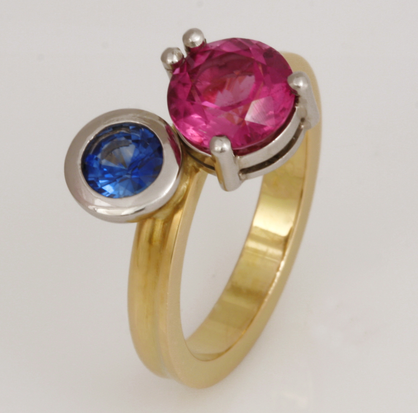 "R076 Handmade by Robert. 18ct yellow gold and palladium Rubelite and Sapphire ring. Size ""M 3/4"". $2730"
