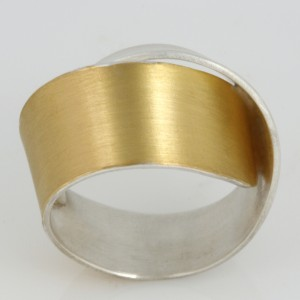 R132 Sterling Silver and gold ladies ring. $515