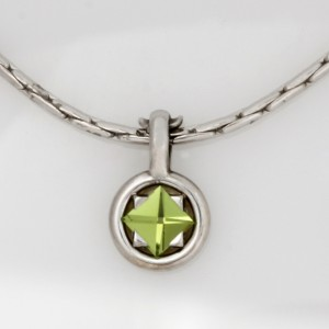 Handmade ladies palladium Perdiot pendant featured on a chain