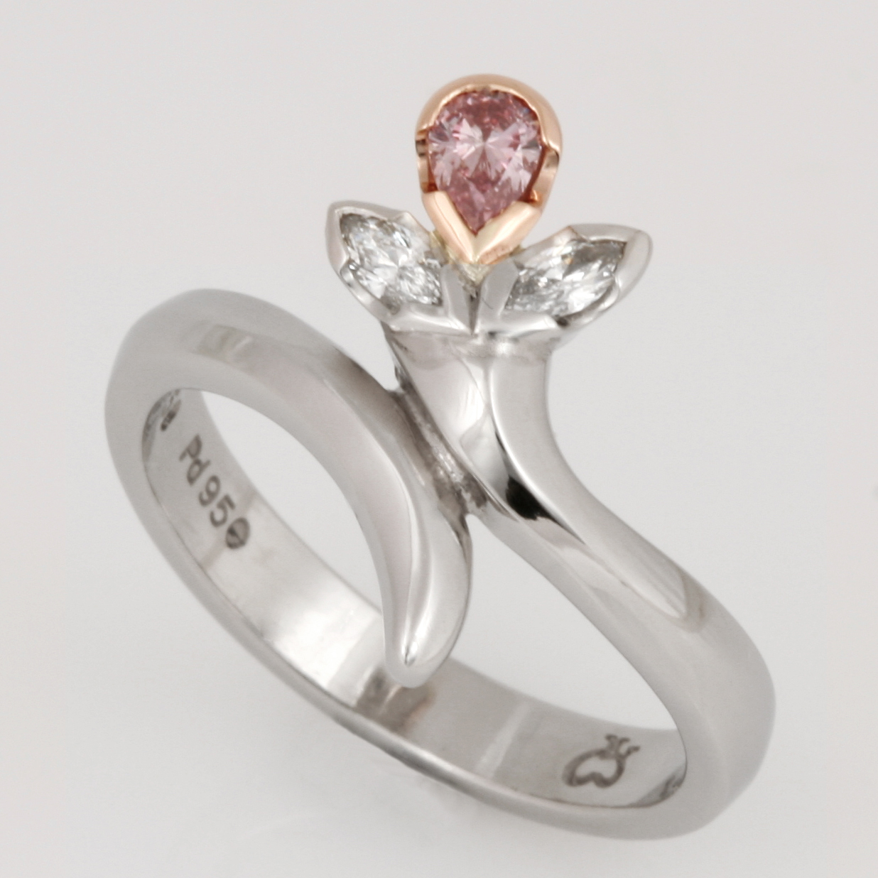 Handmade ladies palladium and 18ct rose gold ring featuring pink and white diamonds