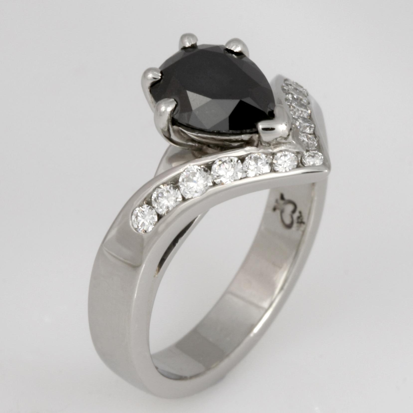 Handmade ladies palladium pear shape black diamond and round white diamond engagement ring