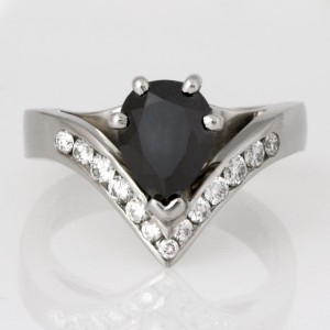 Handmade ladies palladium pear shape black diamond and round white diamond engagement ring