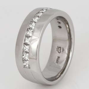 Handmade gents platinum wedding ring featuring princess cut diamonds