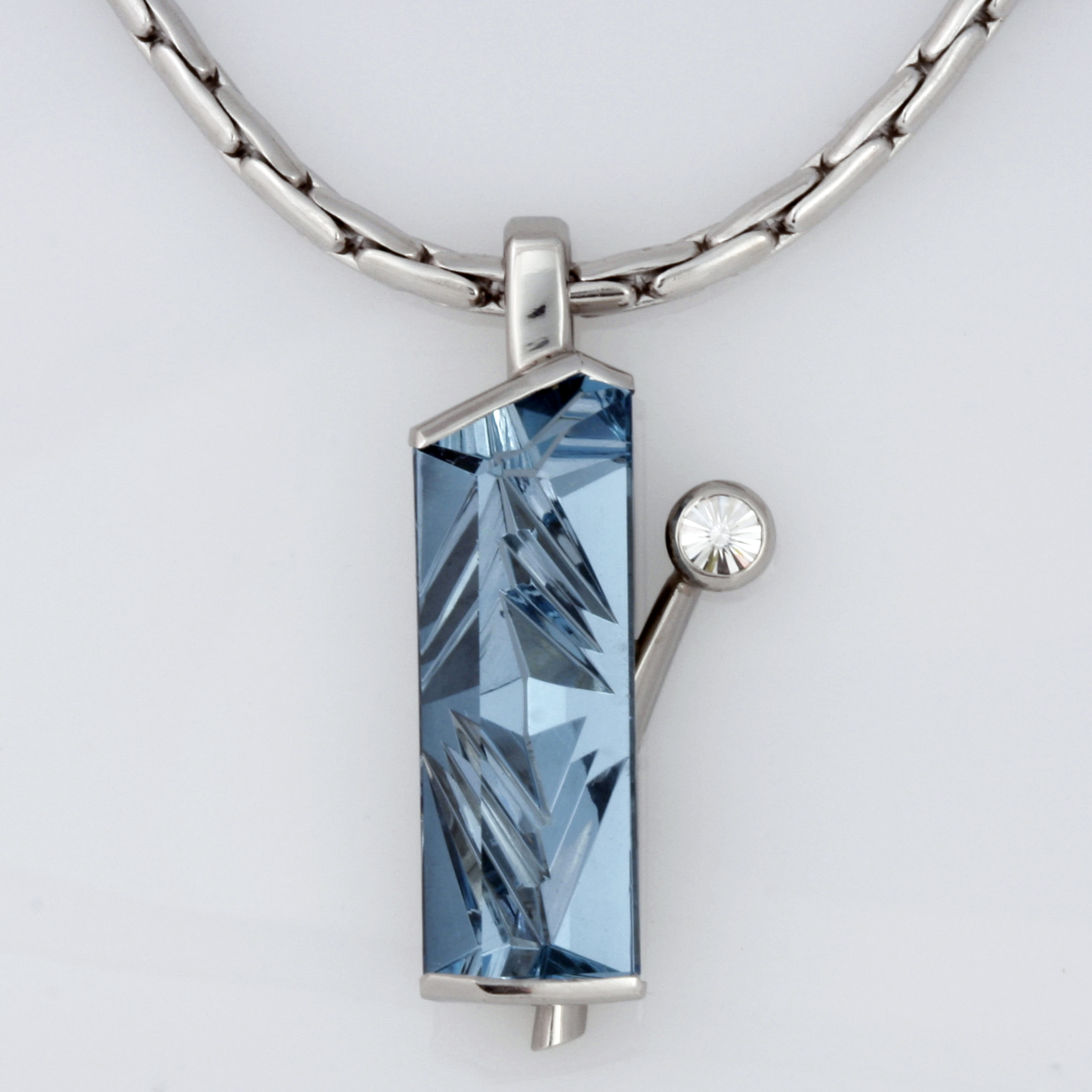 Handmade palladium pendant featuring a German cut aquamarine and a 'Spirit' cut diamond