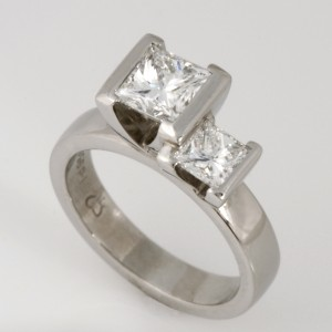 Handmade ladies palladium engagement ring featuring 2 princess cut diamonds