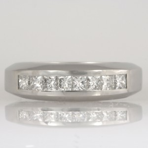 Handmade ladies platinum wedding ring featuring princess cut diamonds