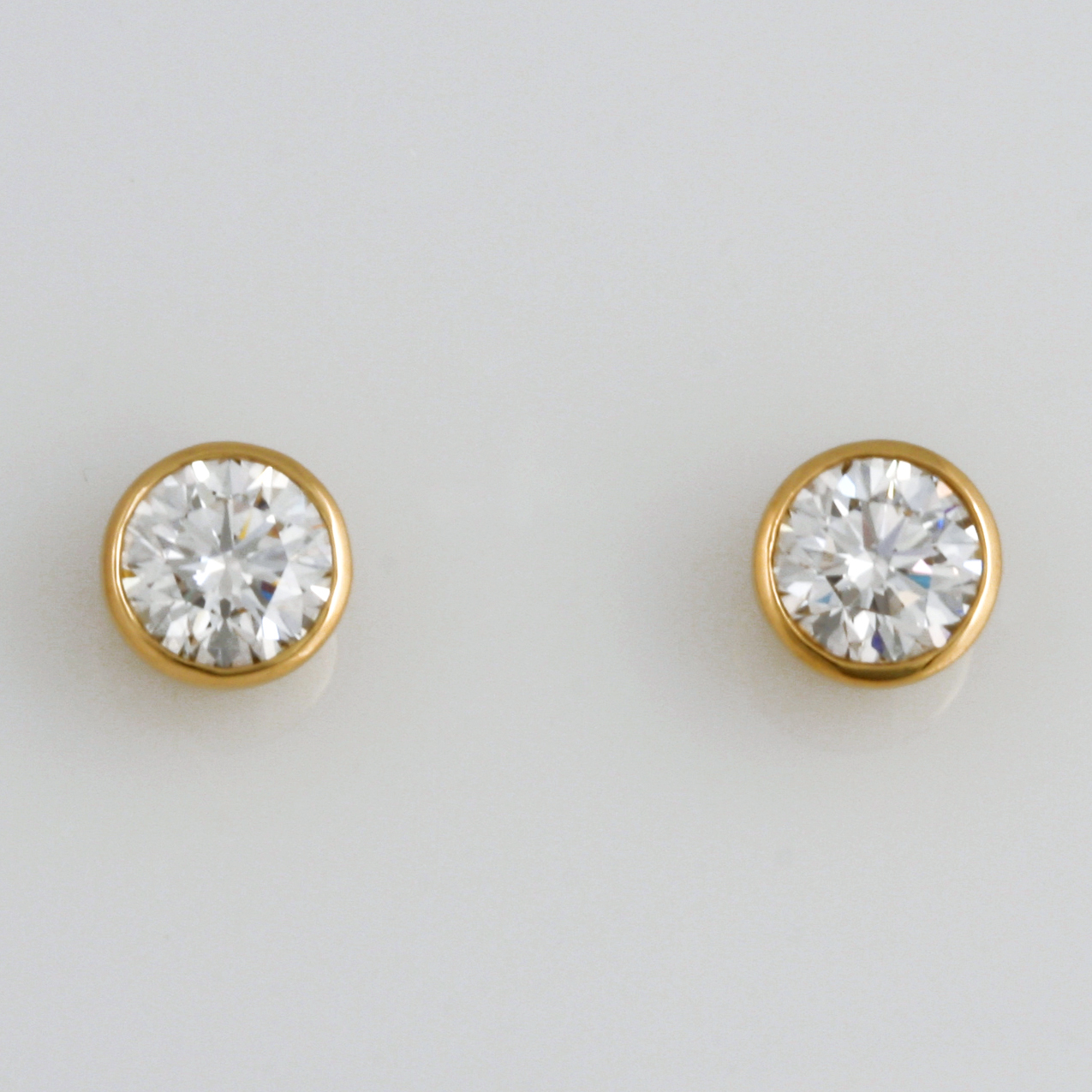 18ct yellow gold stud earrings featuring 0.75ct diamonds in each and threaded post