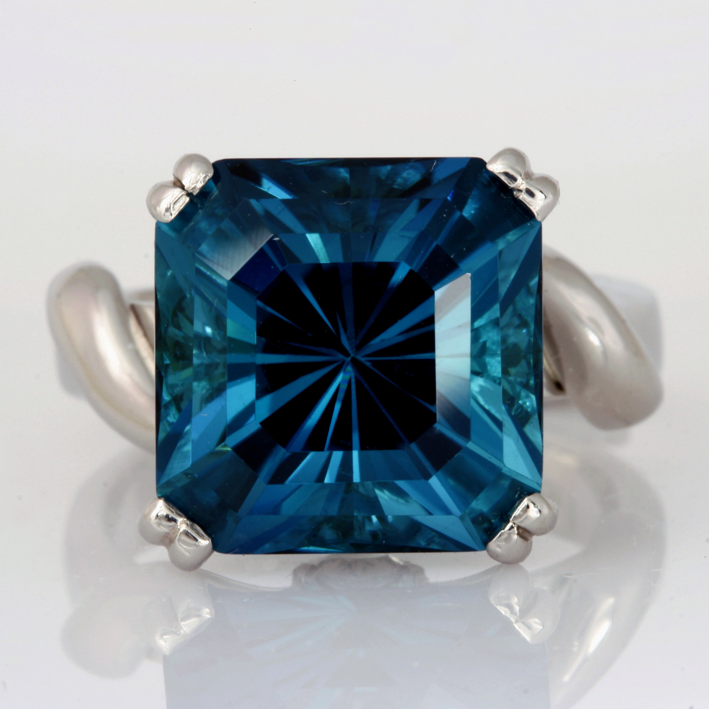 Handmade ladies platinum ring featuring a Indicolite Tourmaline and pear shape diamonds