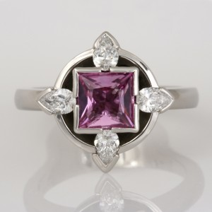 Handmade ladies palladium ring featuring a princess cut pink sapphire and pear shape diamonds