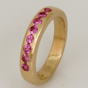 Handmade ladies 18ct yellow gold ring featuring pink sapphires