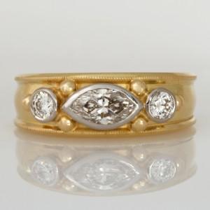 Handmade ladies 18ct yellow gold and palladium ring featuring marquise and round diamonds.