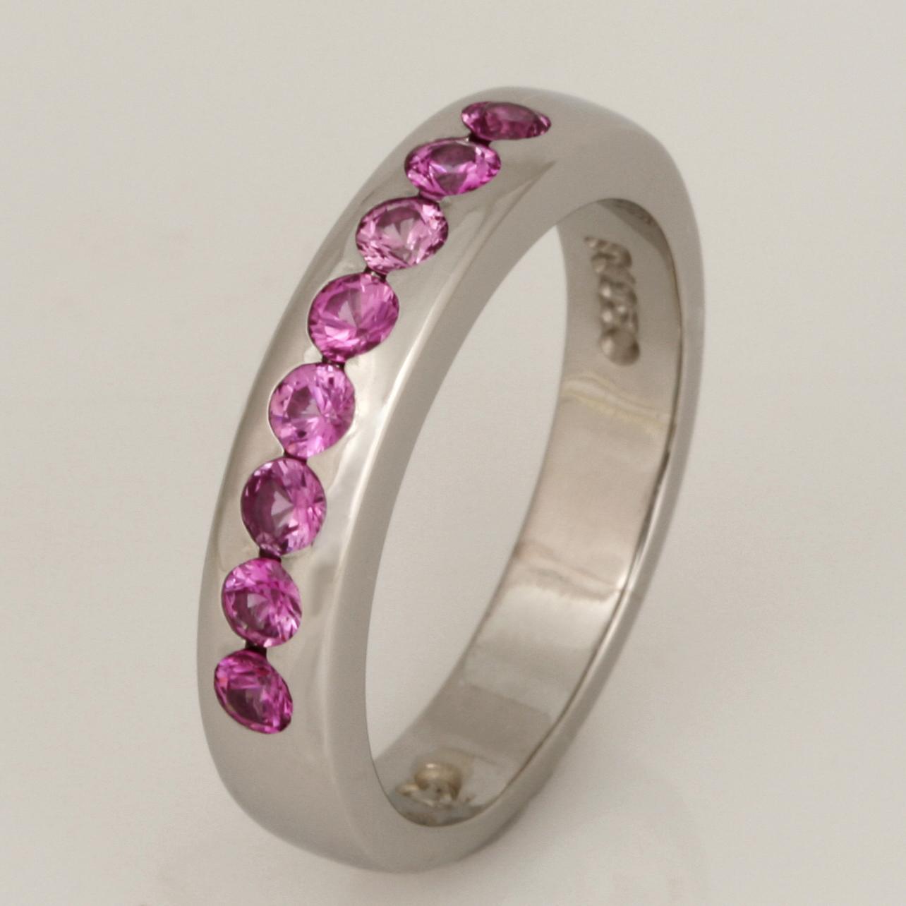 Handmade ladies palladium ring featuring pink sapphires