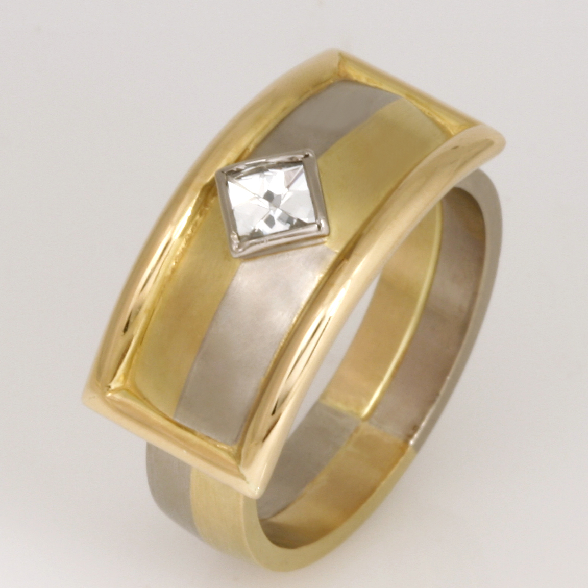 "R055 18ct yellow and white gold Archie style ring featuring a 3.5mm square high reflection cut diamond. Size ""M 1/2""  $3975"