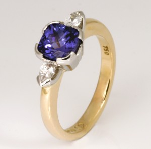 Handmade ladies 14ct yellow gold ring featuring a Tanzanite and diamonds.