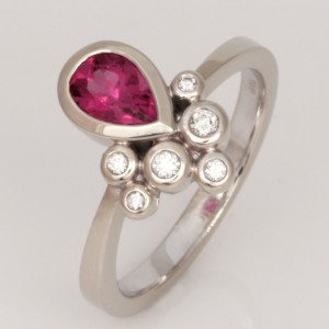 "R120 14ct white gold ladies ring with a 7mm x 5mm pear shape pink tourmaline and 6 round diamonds that equal 0.099cts.  Size ""O""  $1425"
