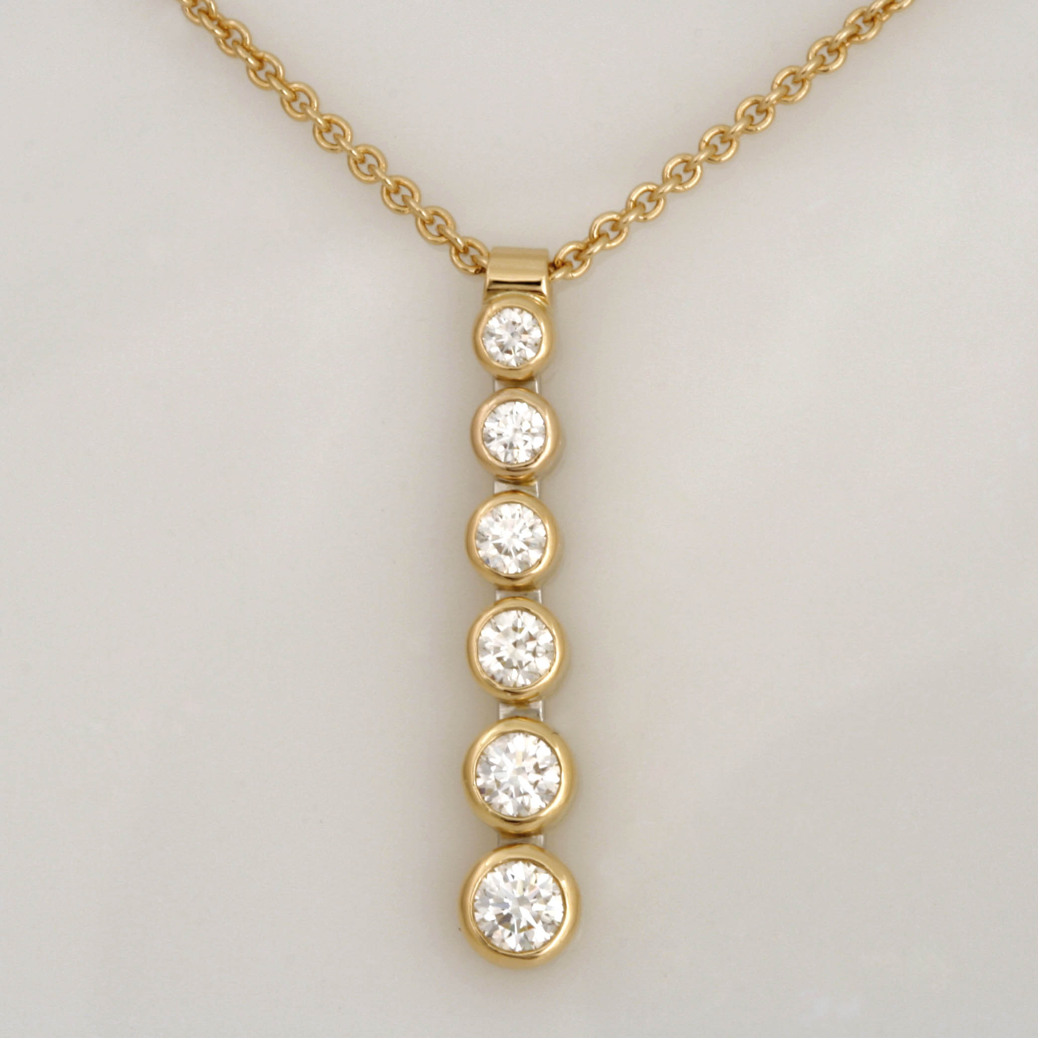 Handmade ladies 18ct yellow gold and platinum diamond pendant and chain.