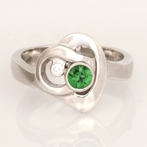 Handmade ladies sterling silver Tsavorite and diamond ring. This ring features two initials intertwined together to represent a heart.