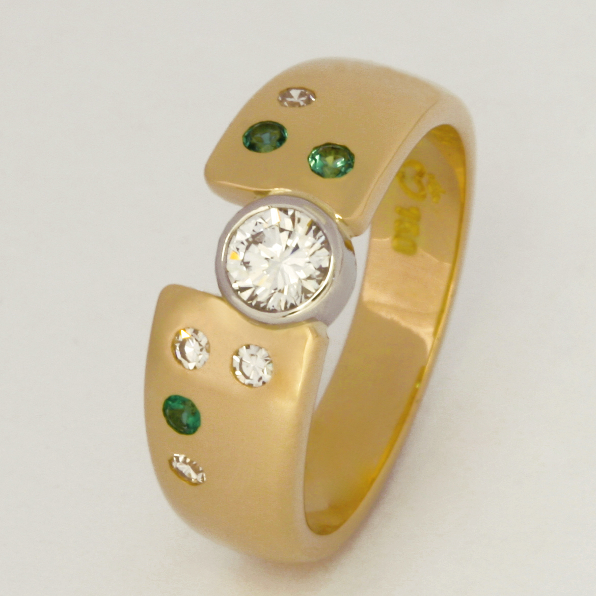 Handmade ladies 18ct yellow gold and palladium ring featuring emeralds and diamonds