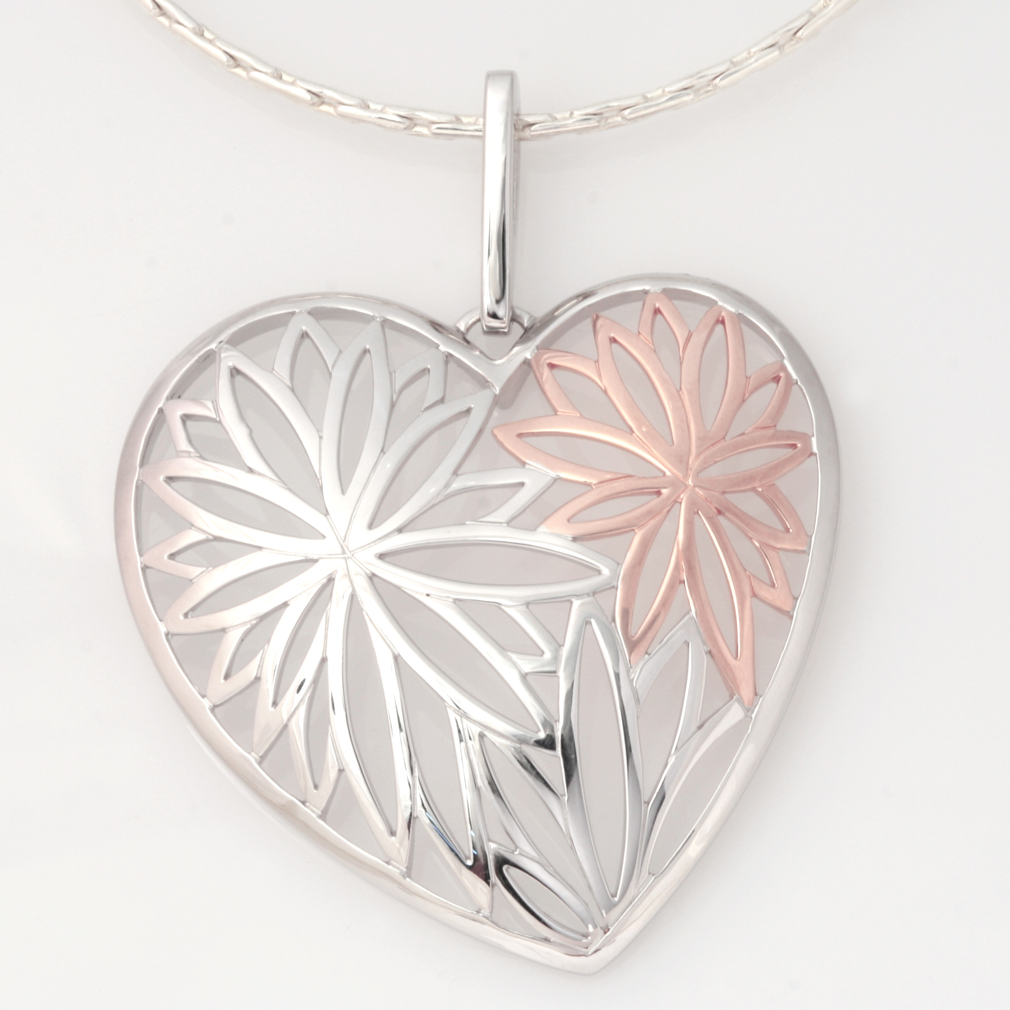 P101 Sterling silver rhodium and rose gold plate heart flower pendant only. $210
