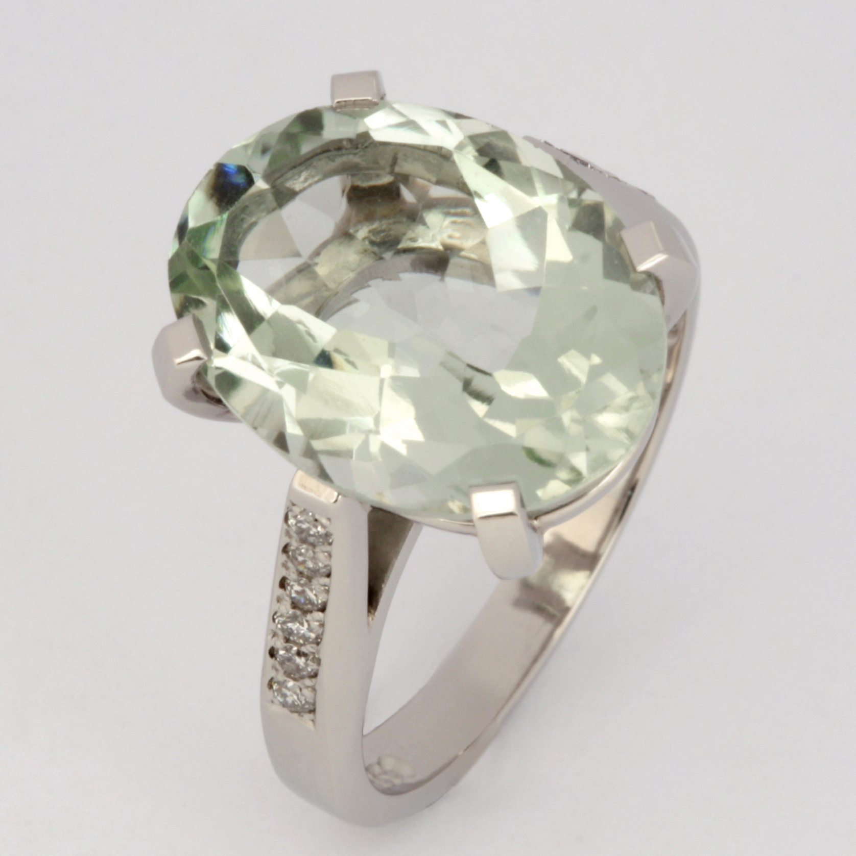 Handmade ladies palladium ring featuring a green amethyst and diamonds
