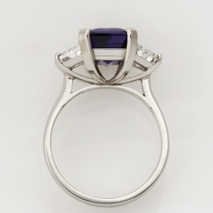 Handmade ladies platinum ring featuring a emerald cut tanzanite and trapezoid side diamonds