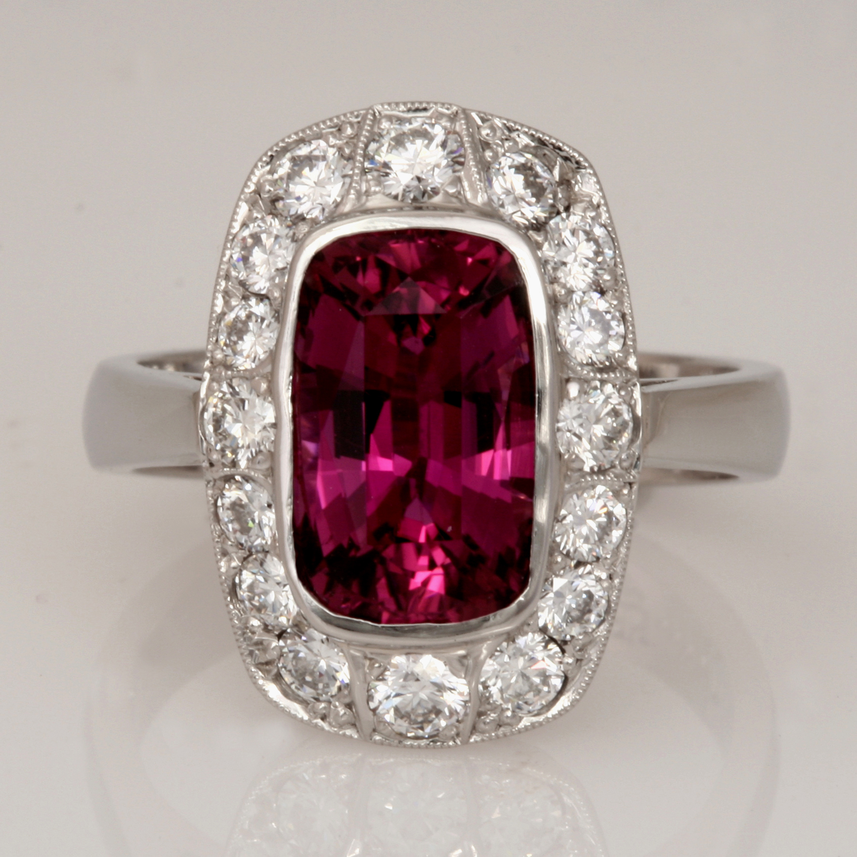 Handmade ladies palladium rectangular cushion cut rubelite and diamond ring featuring a hidden bouquet of green gold and rose gold pressed flowers
