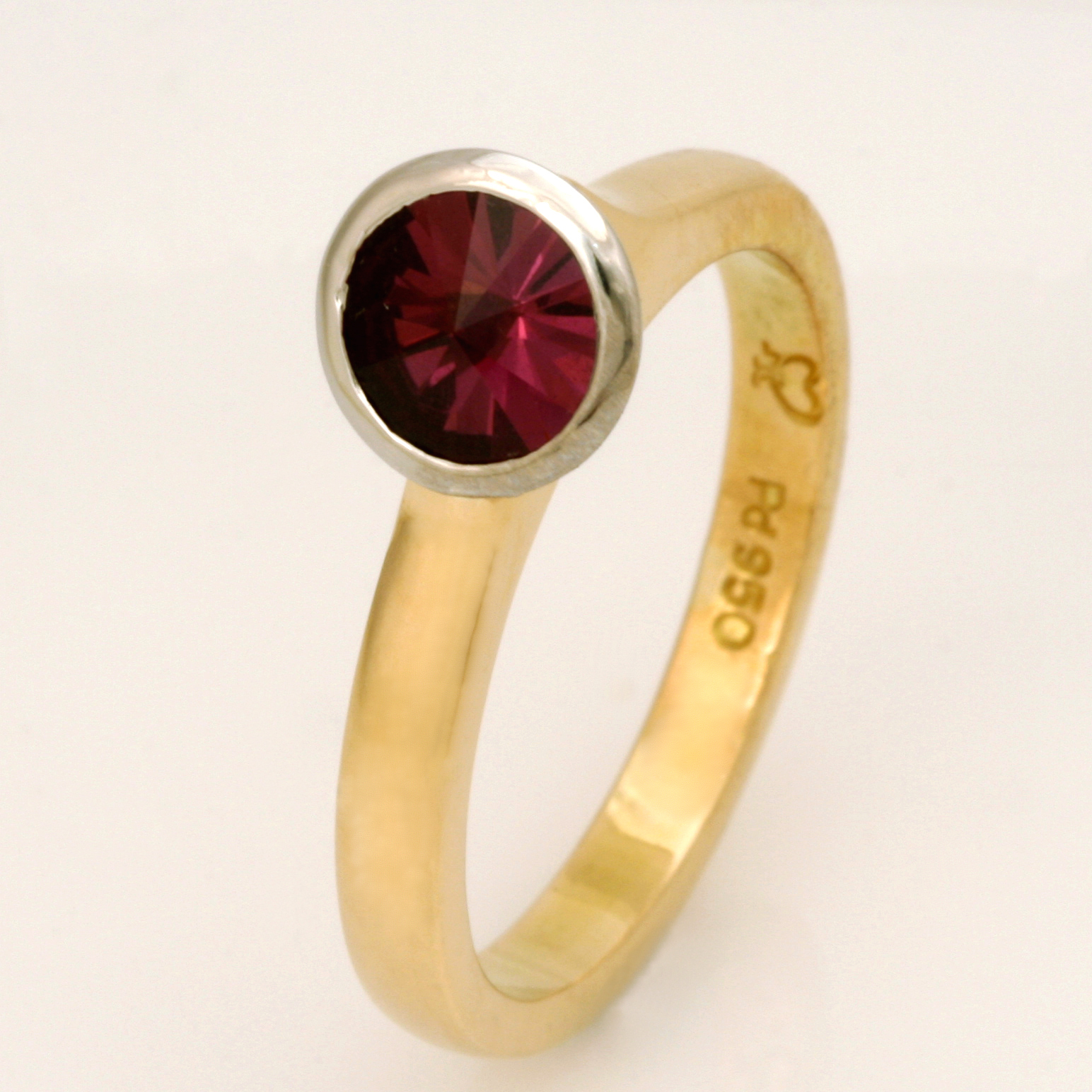 Handmade ladies 18ct yellow gold and palladium ring featuring a Spirit cut rhodolite garnet