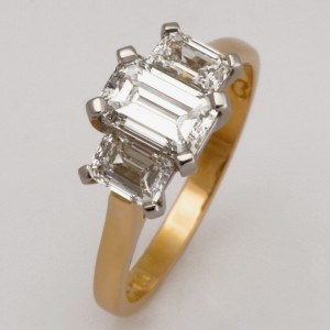 Handmade ladies 18ct yellow gold and platinum ring featuring emerald cut diamonds.